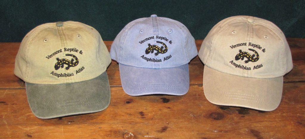 Three hats: bi-color, periwinkle, tan